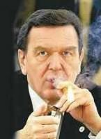 Gerhard Schröder, lighting up his cigar