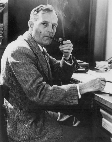 Edwin Powell Hubble smoking his pipe