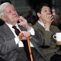 Helmut Schmidt and his wife Loki enjoy a cigarette at a New Year event in Hamburg