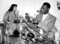 Nat King Cole smoking a pipe